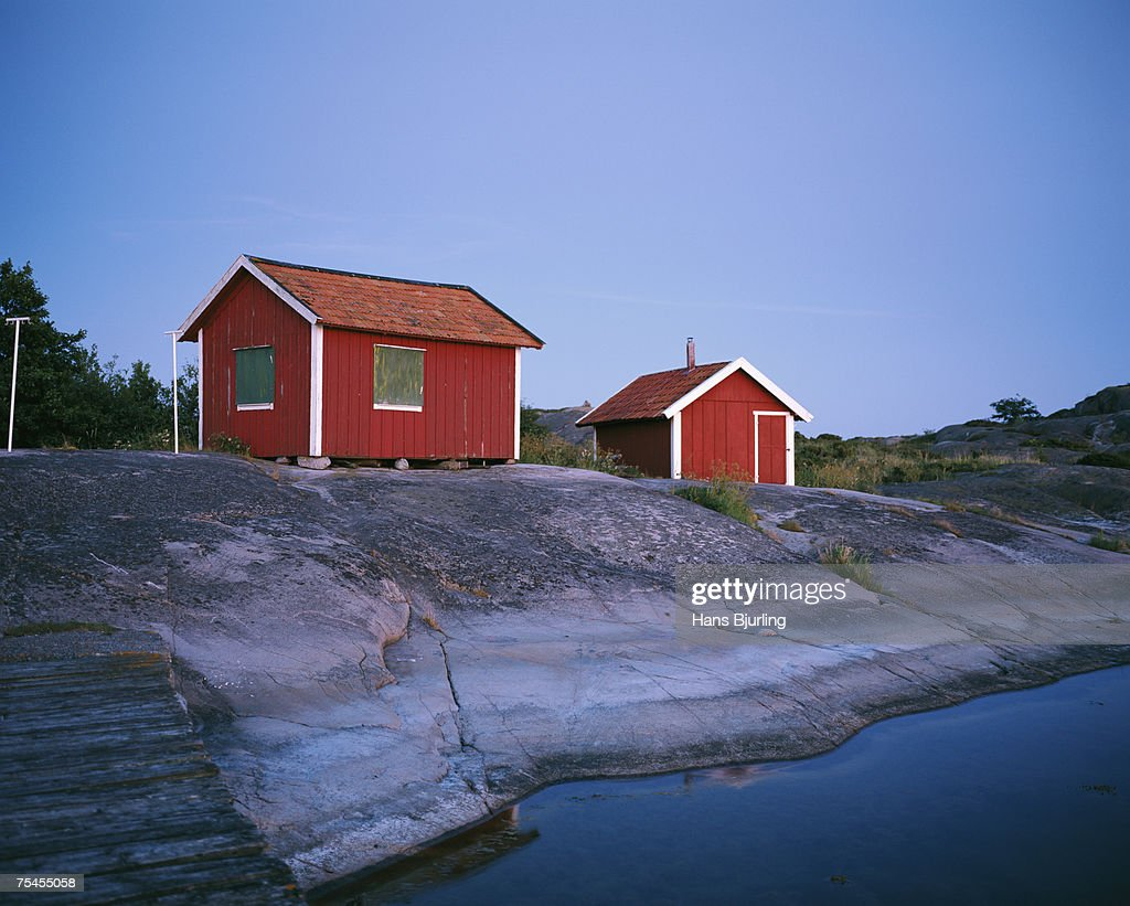 Two red cottages in the archipelago of Stockholm Sweden.