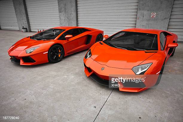 two red lamborghini aventador