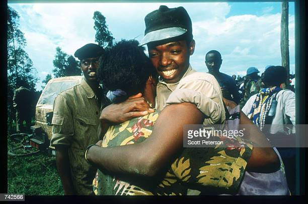 Two refugees are dropped off in Tutsi rebel area May 25 1994 in Kigali Rwanda Following the assassination of President Juvenal Habyarimana in April...
