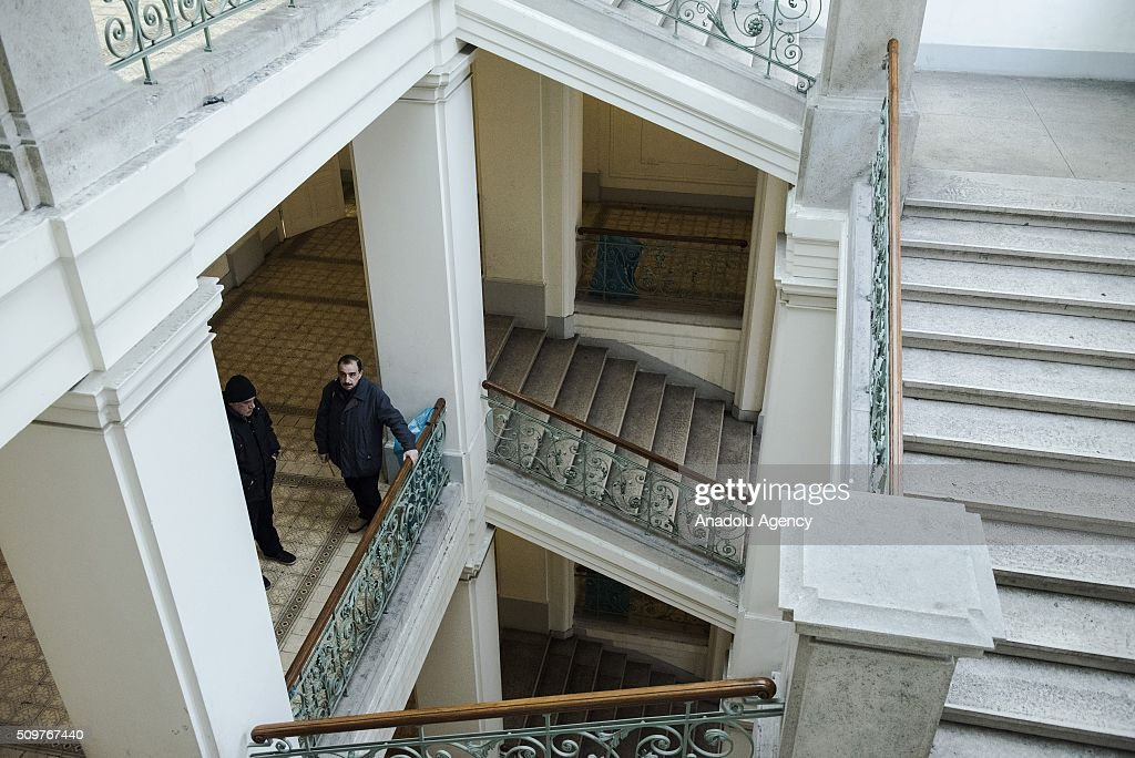 Two refugees stand on the second floor of the Red Cross shelter in Vienna, Austria on February 11, 2016. The refugee shelter is located right in the Vienna city centre, inside the building belonging to the University of Applied Arts. The premises were rented by the university to the Austrian Red Cross in 2015. According to this agreement, the shelter started operating in October 2015 and it will be open until May 2016. The Red Cross shelter has a capacity to host 1400 persons and 775 refugees live there. Around 90% of the refugees living in the shelter come from Iraq, Syria or Afghanistan. Over the last seven months, around 90,000 asylum seekers have applied for refuge in Austria, and at least 50,000 of these are expected to be deported. Military aircraft have been requisitioned for this purpose. The government also wants to cut social support to these asylum seekers.