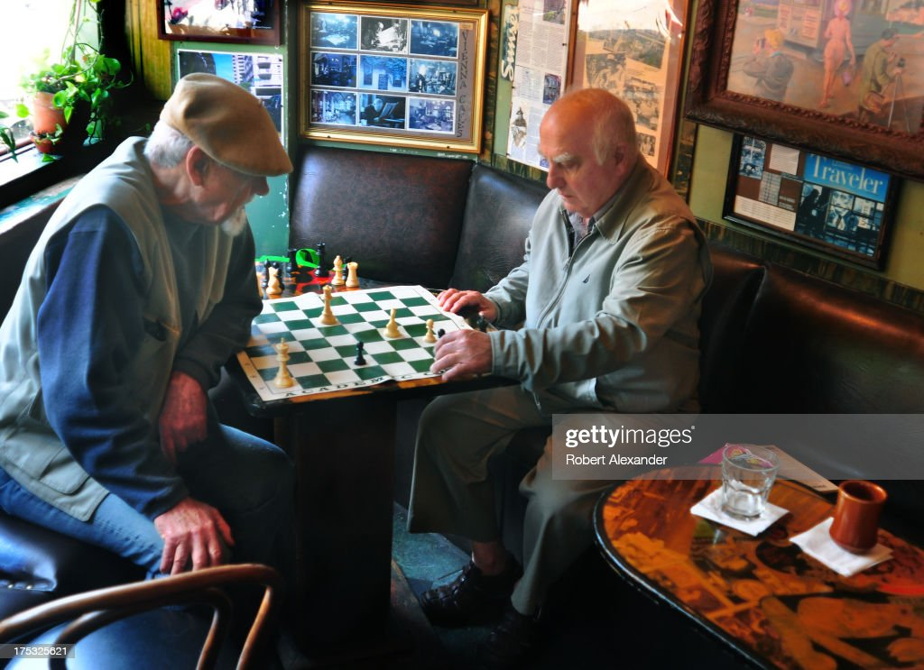 Two regular patrons play chess at the Vesuvio Cafe in San Francisco, a hangout for members of the Beat Generation in the 1950s and still popular with bohemian lovers of literature, poetry and jazz. Located in the city's North Beach district, the Vesuvio Cafe is next door to Lawrence Ferlinghetti's City Lights Bookstore, another gathering place of Beat artists such as Allen Ginsberg and Jack Kerouac.