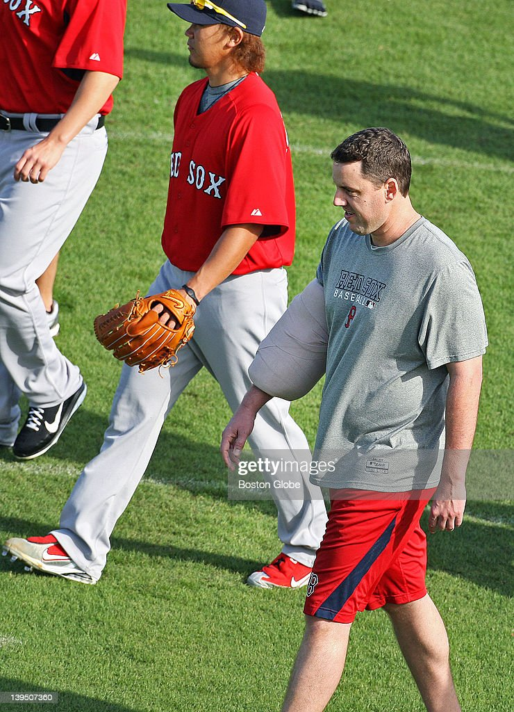 Two rehabbing Red Sox starters, Daisuke Matsuzaka, top, and John Lackey, bottom, head off the field following the team meeting that Bobby Valentine, not pictured, just presided over. The Boston Red Sox are conducting Spring Training workouts at the team's new 106 acre Spring Training and Player Development Complex known as 'JetBlue Park at Fenway South.'