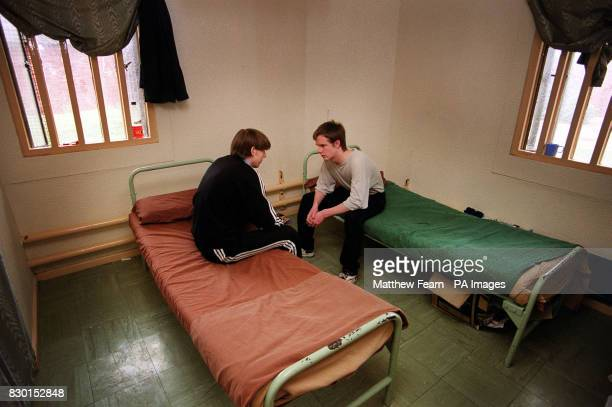 Two remand prisoners chat in their cell in Quail house block Feltham Young Offenders Institution London The prison was today savaged as an affront to...