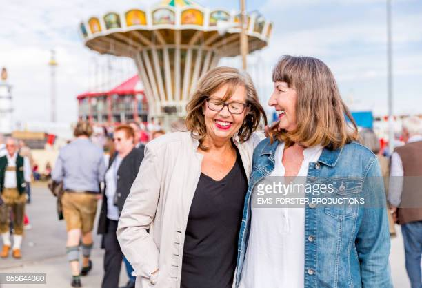Two retired active senior pensioners enjoying time together while visiting Oktoberfest in Munich.