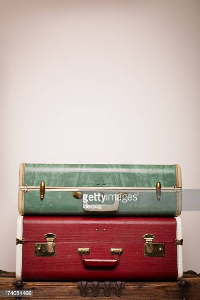 Two Retro Suitcases Stacked on Wood Trunk, With Copy Space