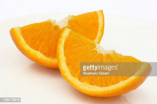 Two ripe, juicy Jaffa orange quarters