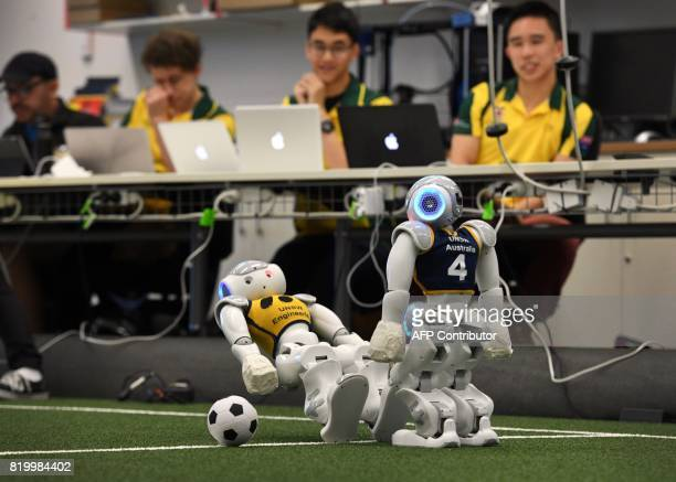 Two robots battle it out for the soccer ball in Sydney on July 21 as Australias fivetime world champions of robot soccer the University of New South...