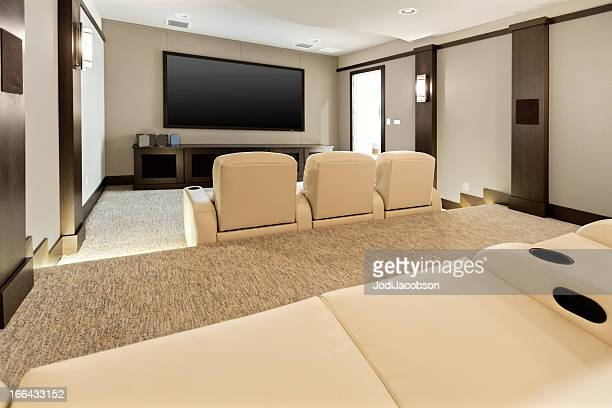 Two room home theatre with large flat screen tv.