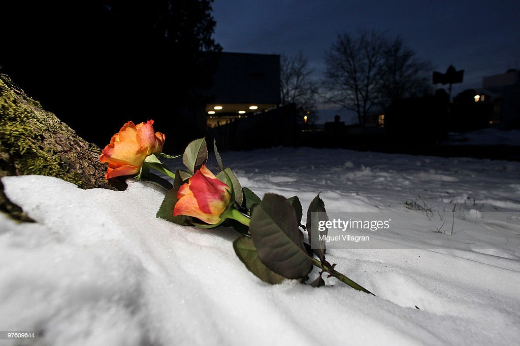 Two roses are pictured in the snow in front of the Albertville School on March 10, 2010 in Winnenden, Germany. Tim Kretschmer opened fire on teachers and pupils at his former school on March 11, 2009, killing 15 and leaving many more injured. Kretschmer fled the scene and shot himself dead after being cornered by police.