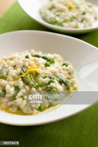Two round plates served with spring risotto