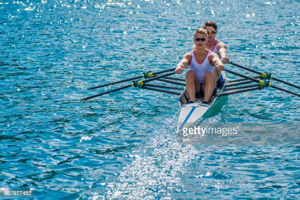 Two rowers on a lake