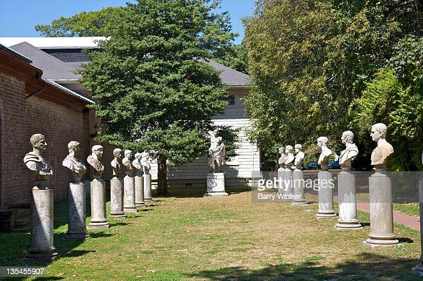 Two rows of classical busts on pedestals.