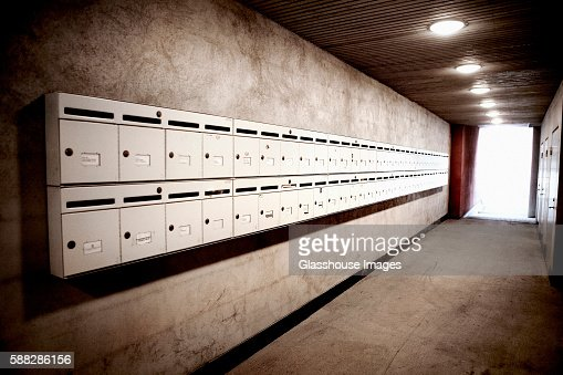 Apartment Building Hallway two rows of mailboxes in apartment building hallway stock photo