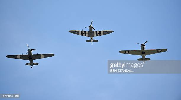 Two royal Air Force Hurricanes and a Spitfire aircraft from the Battle of Britain Memorial Flight conduct a flypast over Horse Guards Parade in...