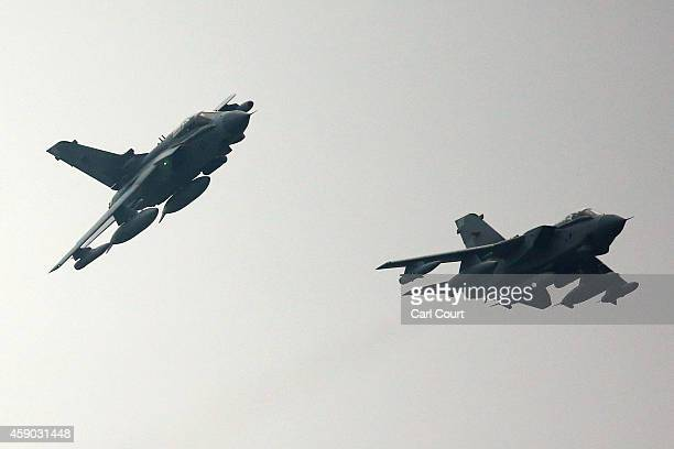 Two Royal Air Force Tornado GR4s prepare to arrive at Royal Air Force Marham on November 15 2014 near the village of Marham in the English county of...