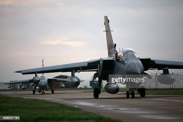 Two Royal Air Force Tornado GR4s taxi along a run way as they arrive at Royal Air Force Marham on November 15 2014 near the village of Marham in the...