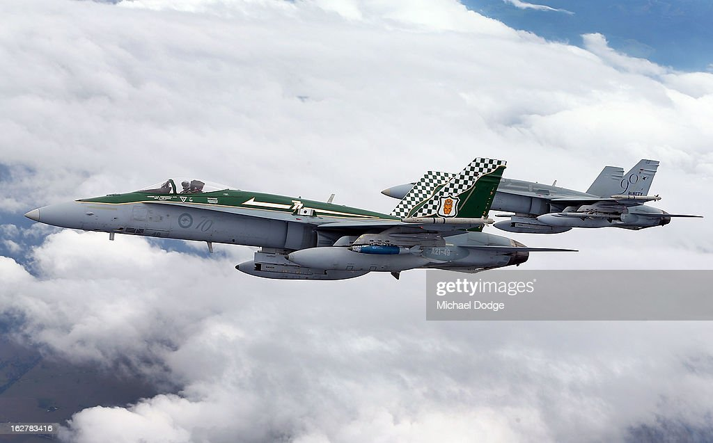 Two Royal Australian Air Force F/A-18 Hornets fly next to a KC-30A Multi Role Tanker Transport aircraft fuel line during the Australian Defence Force Air-To-Air refuelling on February 27, 2013 in Melbourne, Australia. The Australian Federal Government is planning to replace the ageing F/A-18 and already retired F-111 bomber with a fleet of 100 F-35 Lightning ll, at a cost of AUD$16 billion, with the first of the jets to be delivered to the Royal Australian Air Force at the end of 2014.