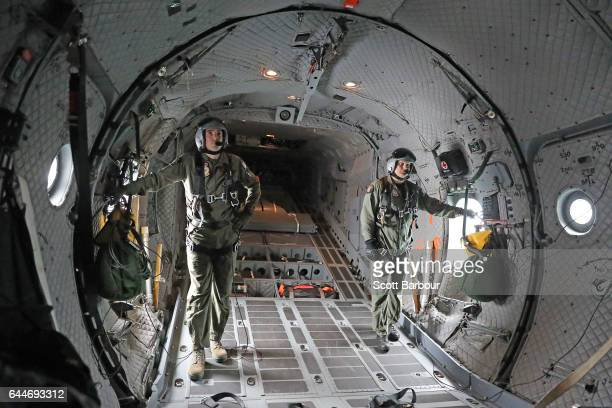 Two Royal Australian Air Force Loadmasters look on in the back of C27 J Spartan as they fly during a media preview ahead of the Australian...
