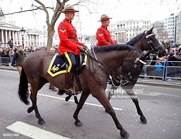Two Royal Canadian Mounted Policemen ride their horses past Trafalgar Square following Queen Elizabeth II's visit to Canada House for it's official...