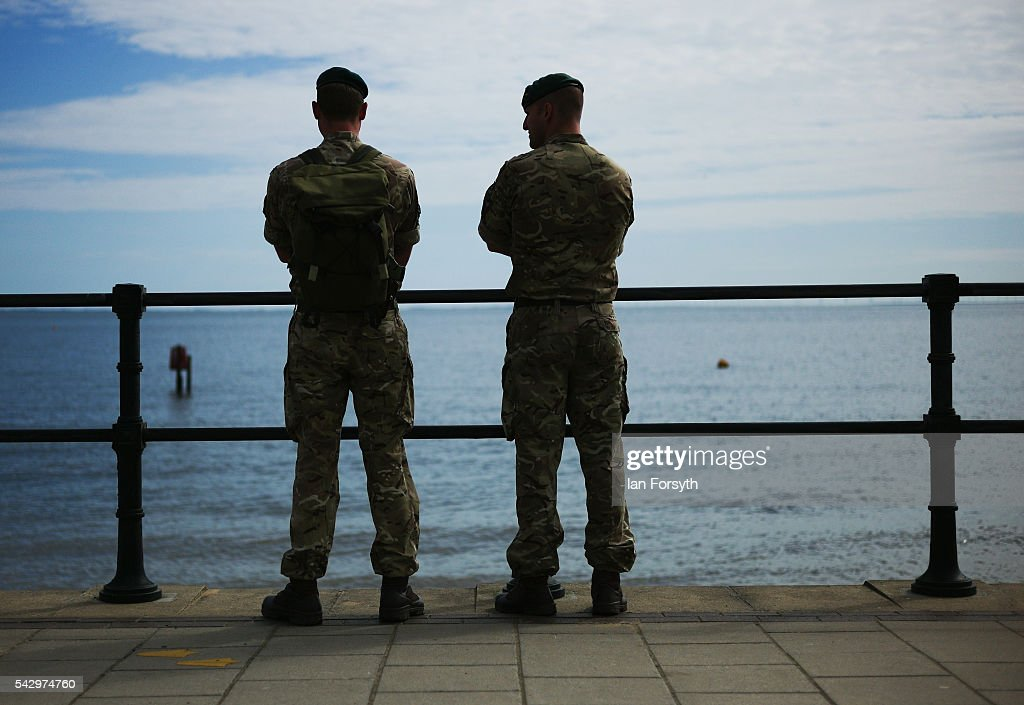 Two Royal Marines Commandos look out to sea during the Armed Forces Day National Event on June 25, 2016 in Cleethorpes, England. The visit by the Prime Minister came the day after the country voted to leave the European Union. Armed Forces Day is an annual event that gives an opportunity for the country to show its support for the men and women in the British Armed Forces.