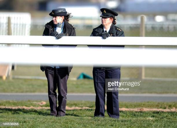 Two RSPCA officers keep an eye on the action at Aintree racecourse on April 04 2013 in Liverpool England