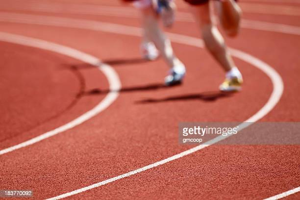 Two runners on a track in running shoes racing