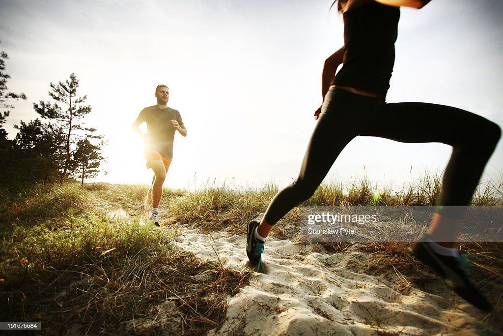 Two runners on track in the morning : Stock Photo