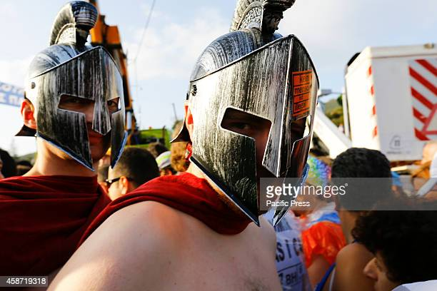 Two runners wear Spartan costumes before the start of the Athens Marathon More than 13000 took part in the 32nd annual Athens Marathon The Authentic...