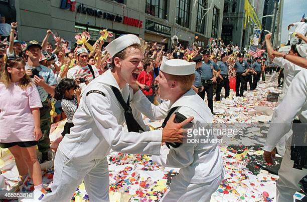 Two sailors embrace as they meet in the middle of Broadway Avenue during the Operation Welcome Home parade during the 10 June 1991 celebration for...