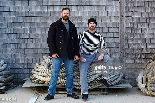 Two Sailors with piles of rope