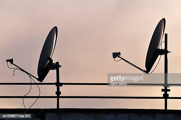 Two Satellite dishes and sunset sky