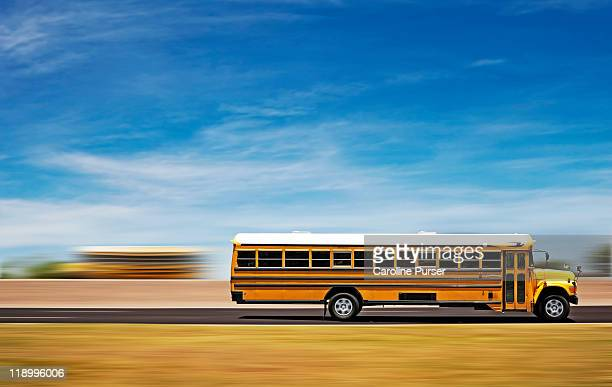 Two school buses on a highway