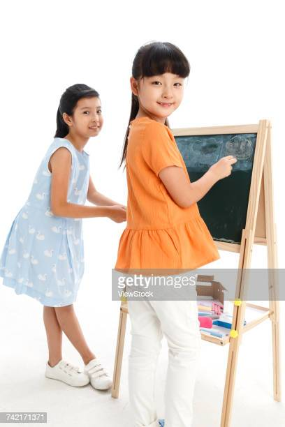Two school girls with drawing board