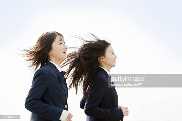 Two School Students Running