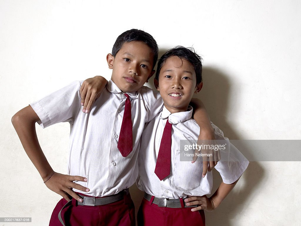 Two schoolboys (9-11) embracing, portrait, close-up
