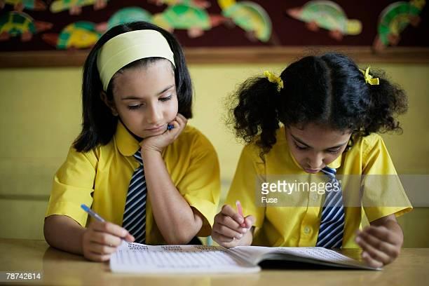 Two Schoolgirls in Classroom