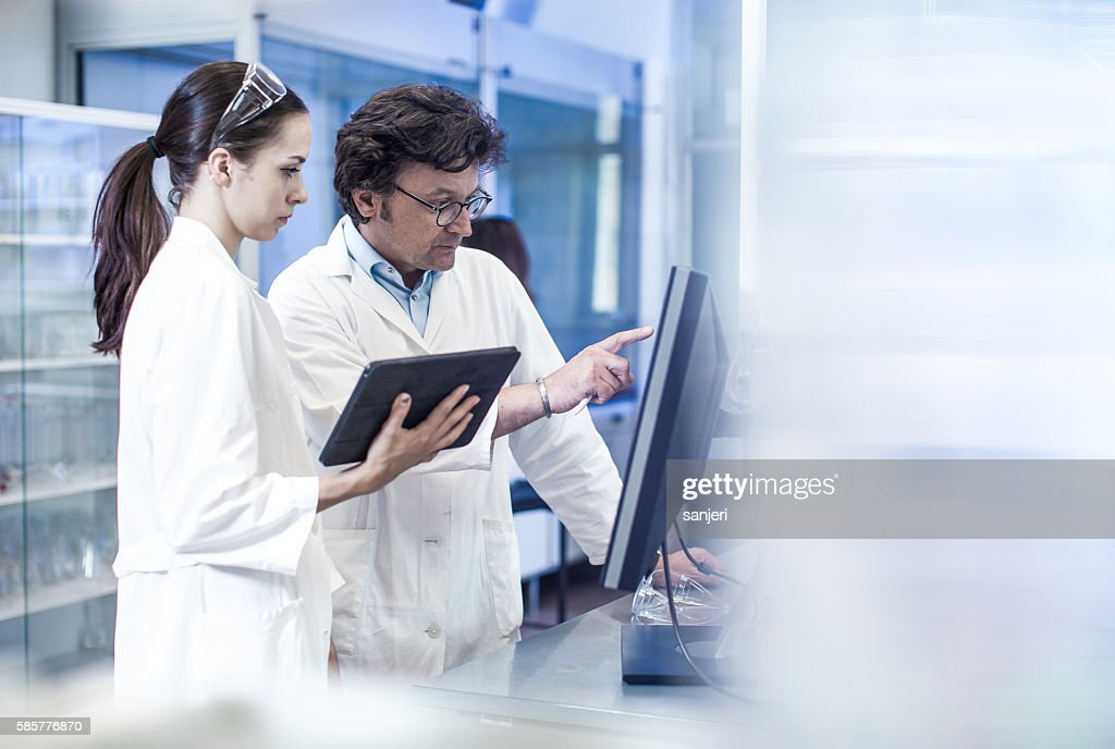 Two Scientist Looking at the Computer Monitor : Stock Photo
