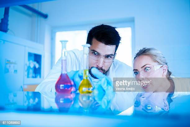 Two scientist working in laboratory