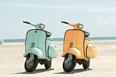 Two scooters on a beach