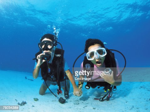 Two scuba divers underwater, portrait : Stock Photo