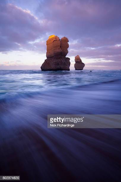 Two sea stacks at Gibsons Steps and a receding wave, Great Ocean Road, Victoria, Australia
