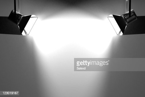 Two searchlights lighting up a blank space