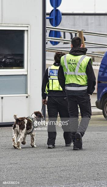 two security officers and dog at Calais Port. France