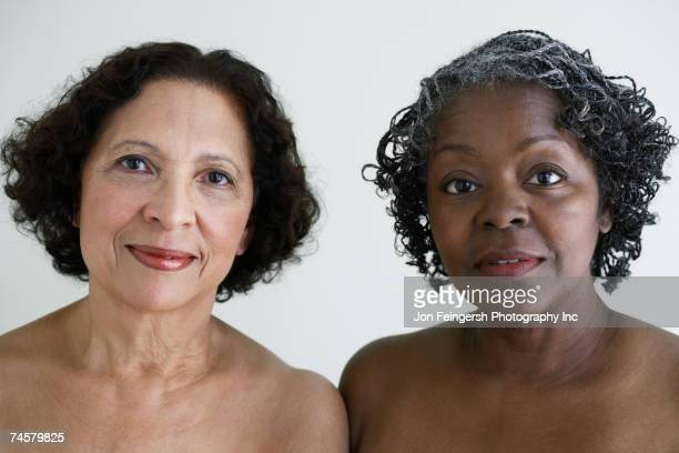 Two senior African women with bare shoulders
