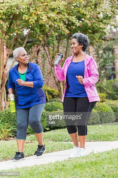 Two senior black women pwer walking