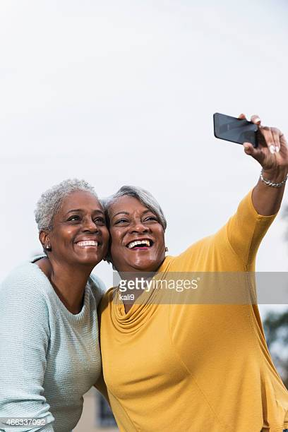 Two senior black women taking a selfie