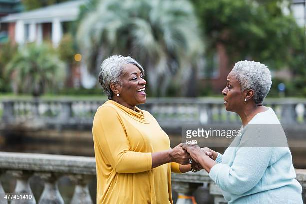 Two senior black women talking outdoors