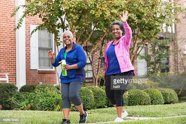 Two senior black women walking for exercise