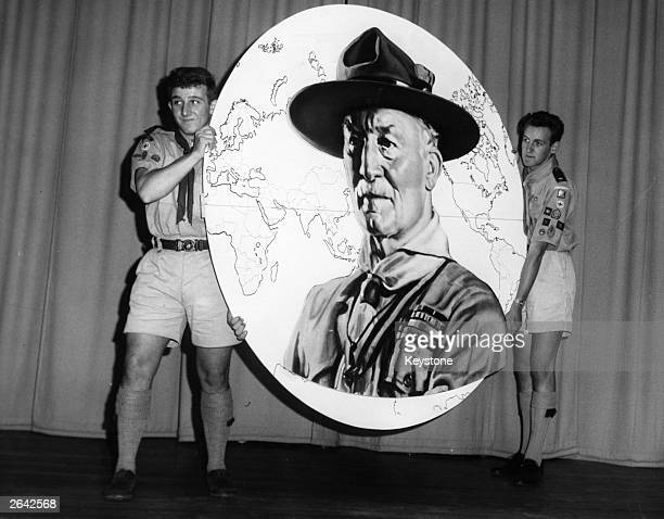 Two senior Boy Scouts with a display portrait of the 1st Baron BadenPowell the founder of the Boy Scout movement