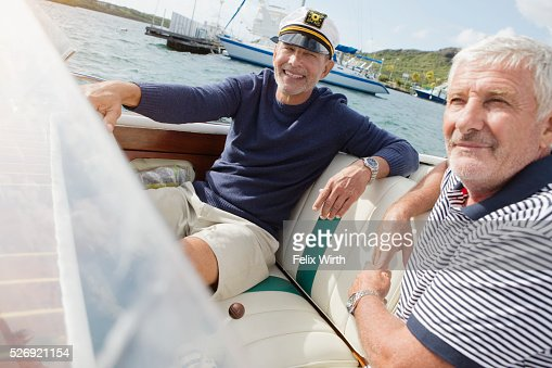 Two senior friends in motorboat : Foto de stock